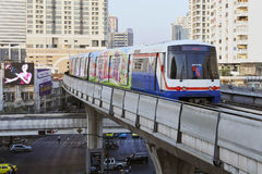 Electric Train on Elevated Rails in Bangkok. BANGKOK - JANUARY 7: BTS Skytrain speeds through the city centre January 7, 2011 in Bangkok, Thailand. The mass Stock Image