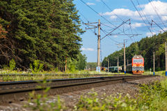 Electric train goes by rail, summer, countryside Stock Photography