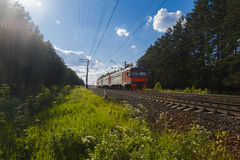 Electric train goes by rail, summer, countryside Royalty Free Stock Image