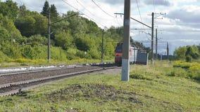 An electric train leaving the railway crossing. Ultra HD 4K stock video
