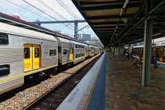 Electric Train at Central Railway Station, Sydney, Australia. An electric train and a long railway platform at Central Railway Station, Haymarket, Sydney, NSW stock image