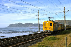Electric train next to the sea, South Africa Royalty Free Stock Photo