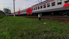 Electric train rides at high speed under the bridge. Lyubertsy, Moscow region, Russia. 6 Sep 2014. Electric train of RZD (Russian railway) rides at high speed stock footage