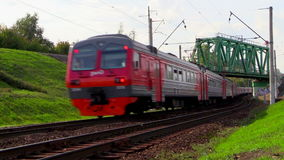 Electric train rides at high speed under the bridge. Lyubertsy, Moscow region, Russia. 6 Sep 2014. Electric train of RZD (Russian railway) rides at high speed stock video footage