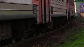 Electric train rides at high speed under the bridge. Lyubertsy, Moscow region, Russia. 6 Sep 2014. Electric train of RZD (Russian railway) rides at high speed stock video