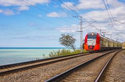 Electric train on seacoast Royalty Free Stock Images