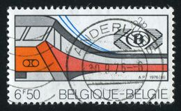 Electric Train and Society Emblem. RUSSIA KALININGRAD, 20 OCTOBER 2015: stamp printed by Belgium, shows Electric Train and Society Emblem, circa 1976 royalty free stock photos
