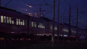 Electric train at the station at night.  stock footage