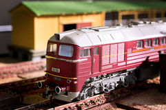 Electric train toy, rail transport modelling. Red locomotive V 200 025 at the station royalty free stock photos