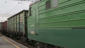Electric train traveling on railway tracks stock video footage
