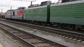 Electric train traveling on railway tracks stock video
