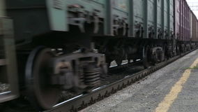 Electric train traveling on railway tracks, close up. Electric train traveling on railway tracks stock footage