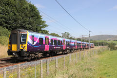Electric train on West Coast Mainline in Cumbria Royalty Free Stock Images