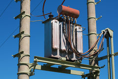 Electric transformer. On transmission tower stock images