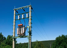 Electric transformer. On transmission tower royalty free stock photography
