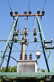 Electric transformer. On transmission tower Royalty Free Stock Photo