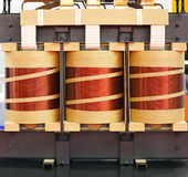 Electric Transformer. Big Industrial Electric Transformer Device With Copper Wire Coils Royalty Free Stock Photos