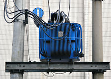 Electric transformer in blue. Blue power electric transformer above the street Royalty Free Stock Photography