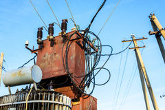 Electric transformer on blue sky background Stock Photo