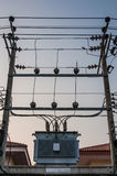 Electric transformer with cable & poles Stock Photos