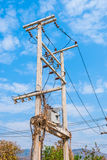Electric Transformer on Concrete Tower with Dry Plants Royalty Free Stock Photo