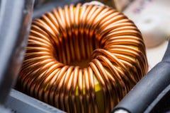 Electric transformer copper coil closeup Royalty Free Stock Photos