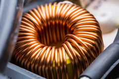 Electric transformer copper coil closeup. Electrical component Royalty Free Stock Photos