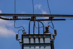 Electric transformer on electric pole Stock Photo