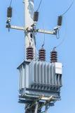 Electric transformer on electric pole Stock Photos