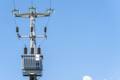 Electric transformer on electric pole Royalty Free Stock Photo