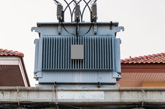 Electric transformer. House at background Royalty Free Stock Photography