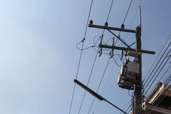 Electric transformer on electric pole stock image