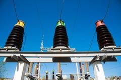 Electric transformer station. High voltage power transformer substation on blue sky background Stock Images