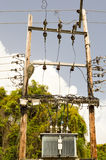 Electric transformer on wooden pylons Stock Image