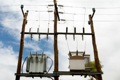 Electric Transformers. On Wooden Poles Royalty Free Stock Images