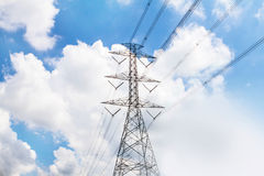 Electric transmission line tower with cloudy sky. The Electric transmission line tower with cloudy sky royalty free stock image