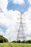 Electric transmission line tower with cloudy sky. The Electric transmission line tower with cloudy sky royalty free stock photography
