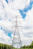 Electric transmission line tower with cloudy sky. The Electric transmission line tower with cloudy sky stock image