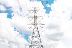 Electric transmission line tower with cloudy sky Stock Photos