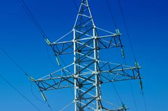Line of electrical transmission, high metal poles with electric. Electric transmission lines supply electricity to residential and industrial areas from power Royalty Free Stock Images