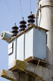 Electric transmission pylons. Close-up of ceramic insulators Stock Photography