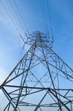 Electric transmission tower 06. Electric transmission tower with bluesky from low angle royalty free stock photo