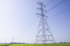 Electric Transmission Tower on filed Stock Images