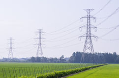 Electric Transmission Tower on filed.  royalty free stock photography