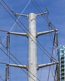 Electric transmission tower and lines. High overhead keeps them isolated from people royalty free stock photos