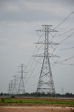 Electric Transmission Tower. In Paddy or rice field at Pathum Thani Province, central Thailand royalty free stock photos
