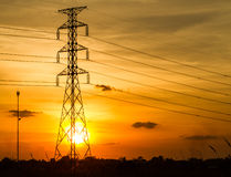 Electric transmission tower. With sunset blackground stock images