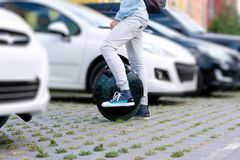 Electric transport compare to diesel fuel cars. Electric balancing unicycle royalty free stock image