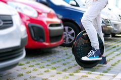 Electric transport compare to diesel fuel cars. Electric balancing unicycle royalty free stock photos