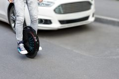 Electric transport compare to diesel fuel cars. Electric balancing unicycle royalty free stock images